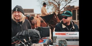 Film crew on location talking