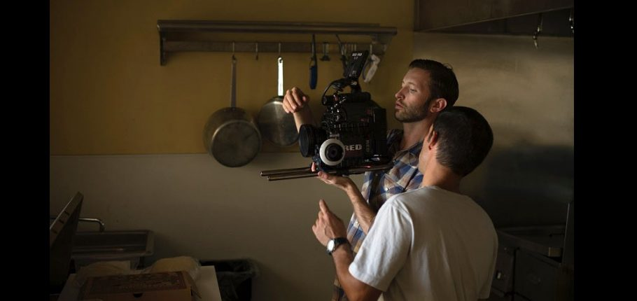 Mentor trains student on filmmaking one-on-one