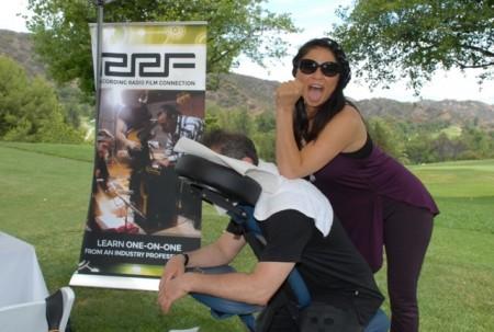 C.O.O. Brian Kraft gets a much-deserved back massage from RRF masseuse Anzu.