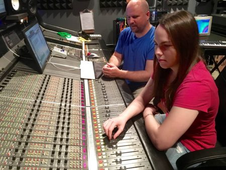 Nicole Thorp and mentor Pierre A. Ferguson at the console