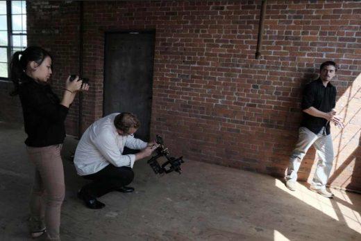 FC students Connie Specyalski and Clinton Mann prep to shoot Michael Ferretti