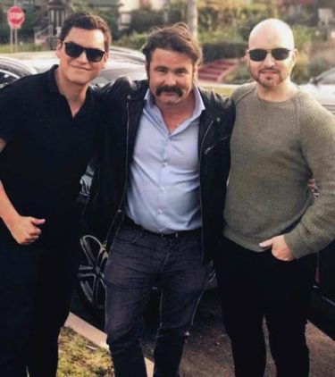 Film Connection student Juan Armijos, actor Mickey Gooch Jr. and mentor filmmaker Rob Weston on the set of Madness in the Method