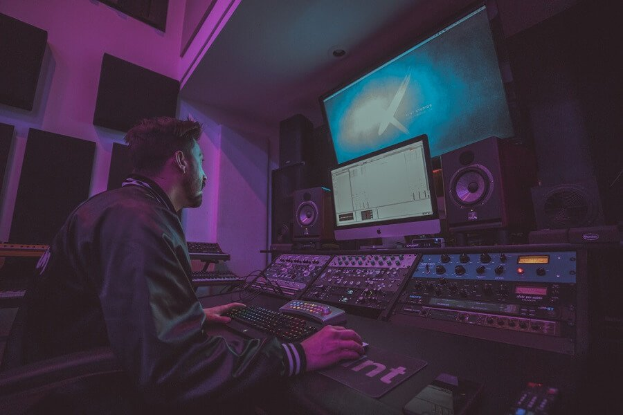 Recording Connection mentor Parker Ament at his workstation making music on DAW