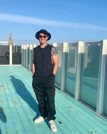 Full body shot of muscian producer Christian Joy-Ito in Los Angeles