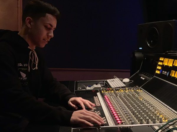 Recording Connection graduate Elijah Ibarra working at Electric Feel Studios in Hollywood, California